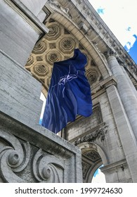 BRUSSELS, BELGIUM - JUNE 14, 2021: NATO flag fluttering in the wind in the arcades of the Cinquentenaire in Brussels