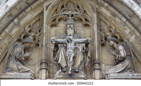 BRUSSELS, BELGIUM - JUNE 15, 2014: The Holy Trinity on the east portal of Notre Dame de la Chapelle gothic church.
