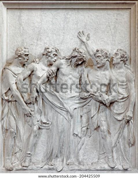 BRUSSELS, BELGIUM - JUNE 15, 2014: Stone relief  Jesus Stripped of His Garments scene in church Notre Dame du Bon Secource.