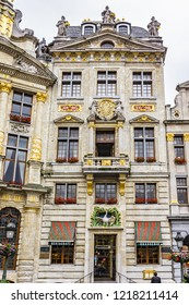 BRUSSELS, BELGIUM - JUNE 19, 2014: Many tourists visiting area of famous Grand Place (Grote Markt) - the central square of Brussels. Grand Place was named by UNESCO as a World Heritage Site in 1998.