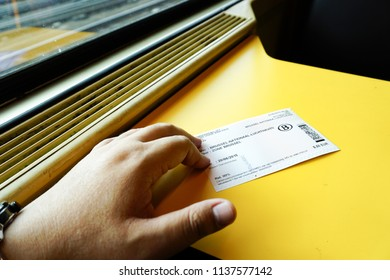 Brussels, Belgium. June 20, 2015. Situation inside the train, holding a ticket while enjoying the ride. Train is one of heavily use public transport in Belgium.