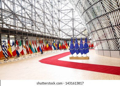 Brussels, Belgium – June 21, 2019: European Union flags swing in Europa building in Brussels.