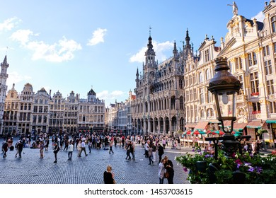 BRUSSELS, BELGIUM - JUNE 21, 2019: Grand Place with people at daylight. Famous buildings and landmarks