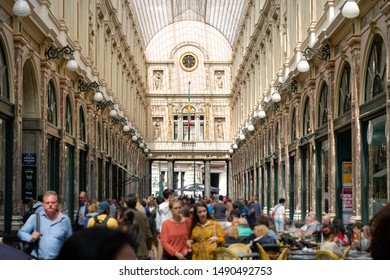 Brussels, Belgium - June 24, 2018 : View of Galeries Royales Saint-Hubert, a glazed glass shopping arcade in Brussels, with blurred people.