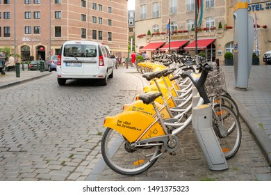 Brussels, Belgium - June 24, 2018 : Yellow public Velo, bicycle rental company, bicycles parking on street of Brussels.