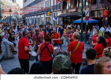 Brussels, Belgium - June 28 2018: Belgium football team fans celebrating on city square. National soccer team Red Devils supporters with team colors playing music during World Cup 2018.