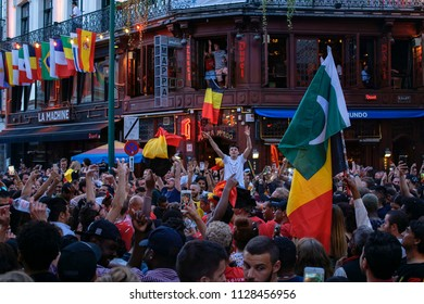 Brussels, Belgium - June 28 2018: Belgium football team fans celebrating on city square. National soccer team Red Devils supporters with team colors and flags during World Cup 2018.
