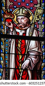 BRUSSELS, BELGIUM - MARCH 13, 2017: Stained Glass in the Church of Our Blessed Lady of the Sablon in Brussels, Belgium, depicting Saint Augustine or Augustinus