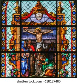 BRUSSELS, BELGIUM - MARCH 13, 2017: Stained Glass in Beguinage Church of Brussels, Belgium, depicting Jesus Christ on the Cross on Good Friday.