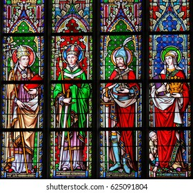 BRUSSELS, BELGIUM - MARCH 13, 2017: Stained Glass in the Church of Our Blessed Lady of the Sablon in Brussels, Belgium, depicting Catholic Saints