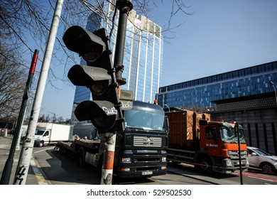 BRUSSELS, BELGIUM - MARCH 17, 2016: Broken traffic light on the foreground of high-rise buildings in the Northern City Center