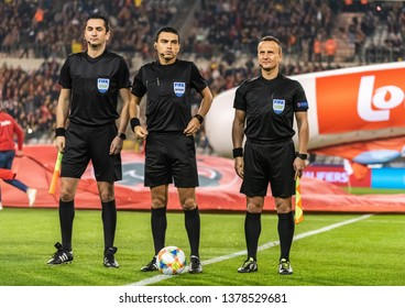 Brussels, Belgium - March 21, 2019. Romanian referees Ovidiu Hategan, Octavian Sovre and Sebastian Gheorghe ahead of UEFA Euro 2020 qualification match Belgium vs Russia in Brussels.