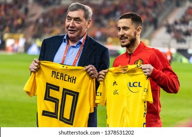 Brussels, Belgium - March 21, 2019. Brussels, Belgium - March 21, 2019. Belgium national team captain Eden Hazard with Belgian former professional road and track bicycle racer Eddy Merckx