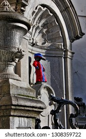 BRUSSELS, BELGIUM - March 25, 2016: Manneken Pis is a landmark small bronze sculpture. His wardrobe includes hundreds of different costumes.