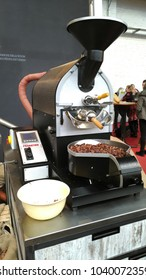 Brussels, Belgium - March 4 2018: Cocoa beans processing machine at Belgian Chocolate Fair 2018