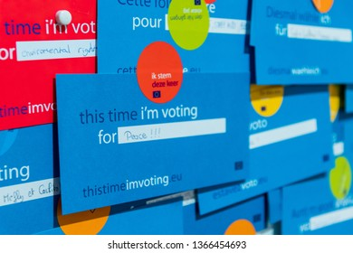 "Brussels, Belgium - March 4, 2019: Voting card in the European Parliament Assembly Room, where members of the EP vote to pass laws in the EU -  Cards and stickers read ""This time I'm voting""."