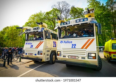 BRUSSELS, BELGIUM - MAY 1, 2021: Riot in Brussels Bois de la Cambre park against Covid-19 restrictions. Police used horses, tear gas and water cannon to disperse revellers at an event called La Boum