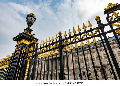 Brussels / Belgium - May 19 2019: Black and gold gates along the perimeter of the Royal Palace of Brussels.