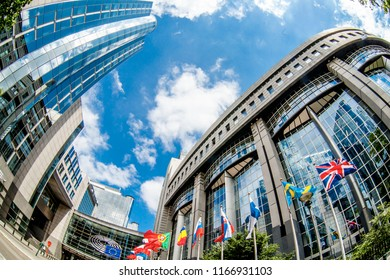 BRUSSELS, BELGIUM - MAY 20, 2015: European Parliament offices and European flags.