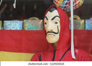 "Brussels / Belgium - May 20 2018: The figure of man in the red hood. He is hero of ""La casa de papel/Paper house"" movie."