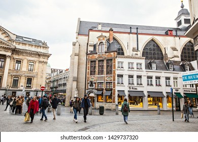 BRUSSELS, BELGIUM - May 2019: Brussels cityscape, historical houses and people on the street, cloudy day in Brussels, Belgium