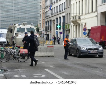 BRUSSELS, BELGIUM - MAY 2019: Police on the streets of the city. Police checkpoint, covering the street. SWAT prepare for the raid. Police blocked the street.