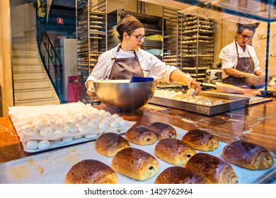 BRUSSELS, BELGIUM - May 2019: Traditional Belgian bakery and sweets shop, women cooking in the shop window, Brussels, Belgium