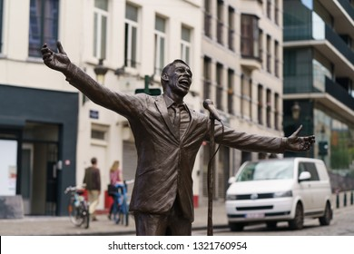 Brussels / Belgium - May 21 2018: Jacques Brel Statue. He is the famous singer. He is presented in position seeing on stage - smiling with open arms to the public.