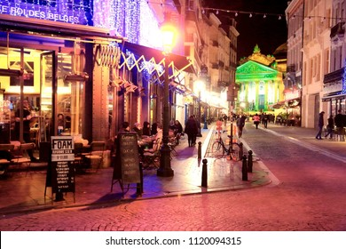 BRUSSELS, BELGIUM - NOVEMBER 19, 2016: People visit Brussels at night. Brussels is the capital city of Belgium. 1.8 million people live in its metro area.