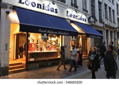 BRUSSELS, BELGIUM - NOVEMBER 19, 2016: People walk by Belgian chocolate store Leonidas in Brussels. There are over 2,000 chocolatiers in Belgium.