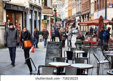 BRUSSELS, BELGIUM - NOVEMBER 19, 2016: People visit Brussels restaurant area. Brussels is the capital city of Belgium. 1.8 million people live in its metro area.