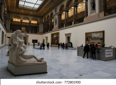 Brussels / Belgium - November 25th 2017 The entrance hall of the Royal Museums of Fine Arts of Belgium with people admiring the fine art pieces