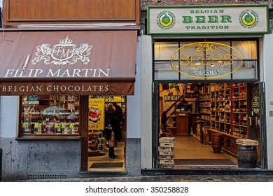 BRUSSELS, BELGIUM - OCTOBER 15, 2015: Street photography with two shops in Bruxelles which represent the Belgian specific. Chocolate and beer traditional.