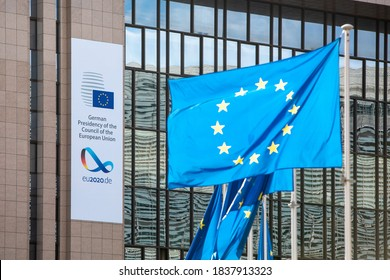 Brussels, Belgium - October 15, 2020: European flags fluttering in the wind in front of the European Council