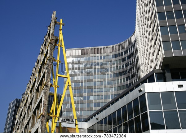 Brussels, Belgium - October 16 2007: House reconstruction in front of a modern office building