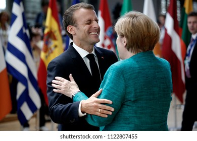 Brussels, Belgium on Jun. 28, 2018.German Chancellor Angela Merkel and French President Emmanuel Macron greet each other as they arrive at an European Union leaders summit