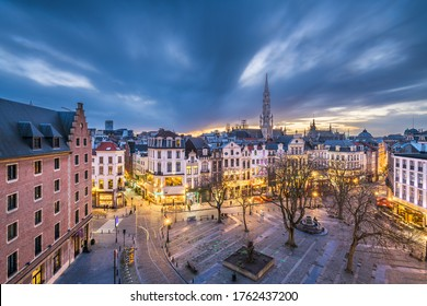 Brussels, Belgium plaza and skyline with the Town Hall tower at dusk.
