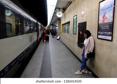 Brussels, Belgium Sep. 16, 2018. Passenger waits on a platform after a commuter train arrived at Central railway station.