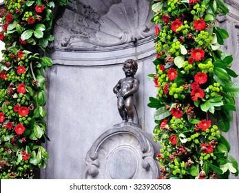 BRUSSELS, BELGIUM - SEP 5,2011 : Manneken Pis statue in Brussels. Statue of a pissing boy in Brussels, Belgium