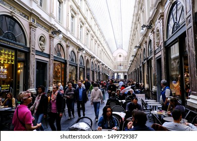 Brussels, Belgium - Sep. 7, 2019 - People shopping at Galeries Royales Saint-Hubert , a glazed shopping arcade in Brussels