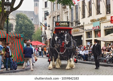 BRUSSELS, BELGIUM - SEPTEMBER 06, 2014: Presentation of the Omer brand with horse carriage during parade of beer manufacturers in Belgian Beer Weekend 2014.