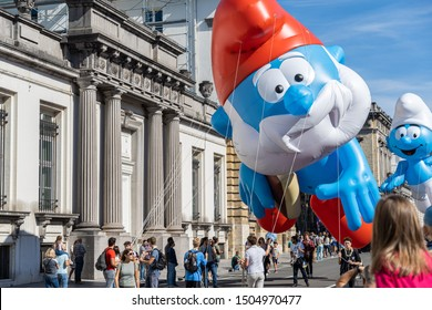 """Brussels, Belgium - September 15, 2019: Balloon's Day Parade during the """"Fête de la BD"""" (event dedicated to comics) in Brussels. Balloons representing the characters of """"The Smurfs"""" (les schtroumpfs)."""