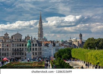 Brussels, Belgium - September 15,2018 : Tourists in scene of Brussels city from Mont des Arts (Mount of the arts) with Town Hall on Grand Place and Equestrian monument of King Albert I