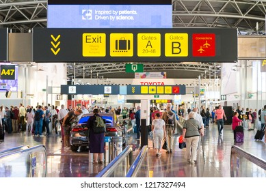 Brussels / Belgium - September 16 2018: People in the Brussels airport terminal. Gate boards in Brussels airport terminal.