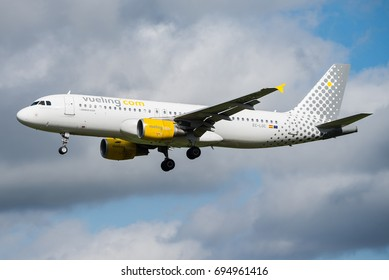 BRUSSELS, BELGIUM - SEPTEMBER 18, 2015: A Vueling Airlines Airbus A320 is landing at Brussels airport on September 18, 2015. Vueling Airlines is a Spanish low-cost airline.
