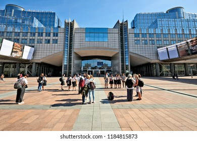 Brussels, Belgium -September 20, 2018:  Some people enjoy september sunny day in front of the European Goverment office at Leopold space in Brussels