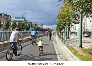 Brussels, Belgium - September 21, 2014: Bicyclist, joggers,skateboarder,horses and walkers enjoy Car Free Streets sunday on Tervueren Ave in Brussels-Belgium