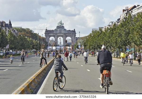 BRUSSELS, BELGIUM - SEPTEMBER 21, 2014:Bicyclist and walkers enjoy Car Free Streets on Tervueren Ave as part of Brussels City's Summer Streets September 21, 2014 in Brussels, Belgium