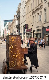 Brussels, Belgium - September 22, 2019: Man playing the piano on Rue Nueve, one of the most popular shopping streets in Brussels.