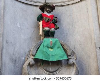 BRUSSELS, BELGIUM - SEPTEMBER 24. Manneken Pis dressed, statue in Brussels on September 24.